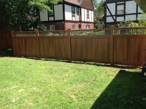 Vinyl wood grain fence with bronze aluminum spindle top combination maintenance free fence Bronxville NY