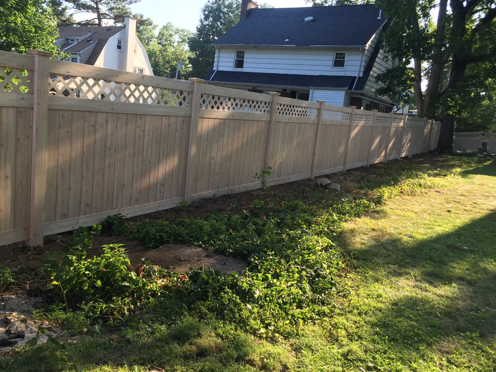 White cedar wood grain vinyl fence