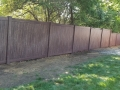 Walnut wood grain vinyl maintenance free fence